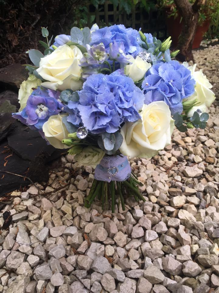 Blue hydrangea and cream rose bridal hand tie