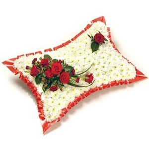 Red and white pillow. based pillow with white chysanths and red rose top spray with ribbon edge £80