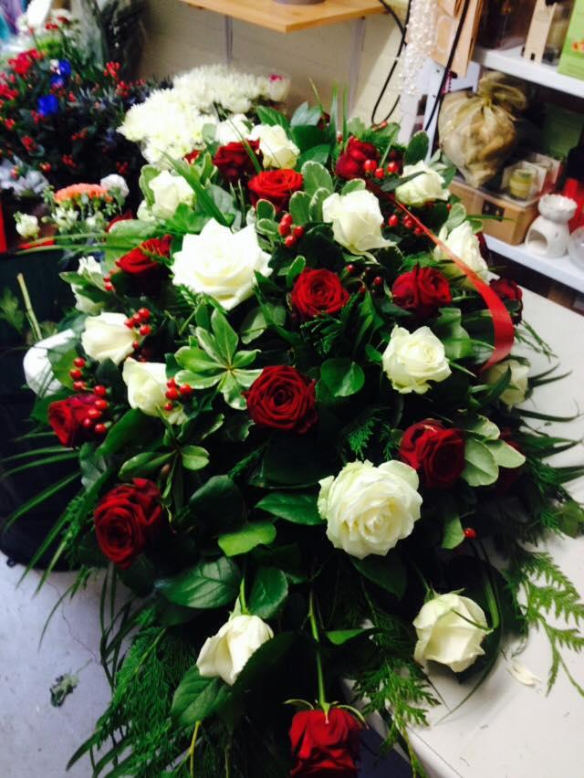red and cream rose casket spray