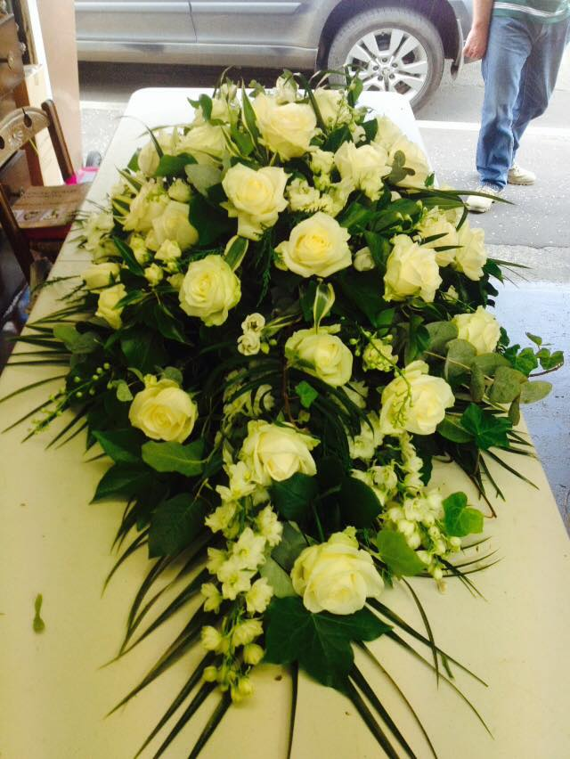 cream rose casket spray