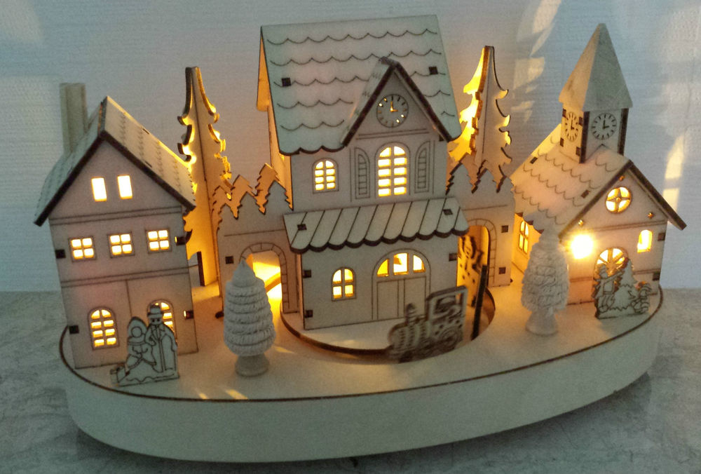wooden-christmas-scene-with-moving-train-and-led