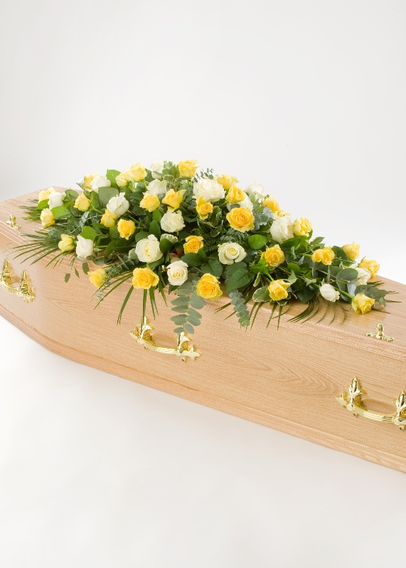 yellow and white rose casket spray