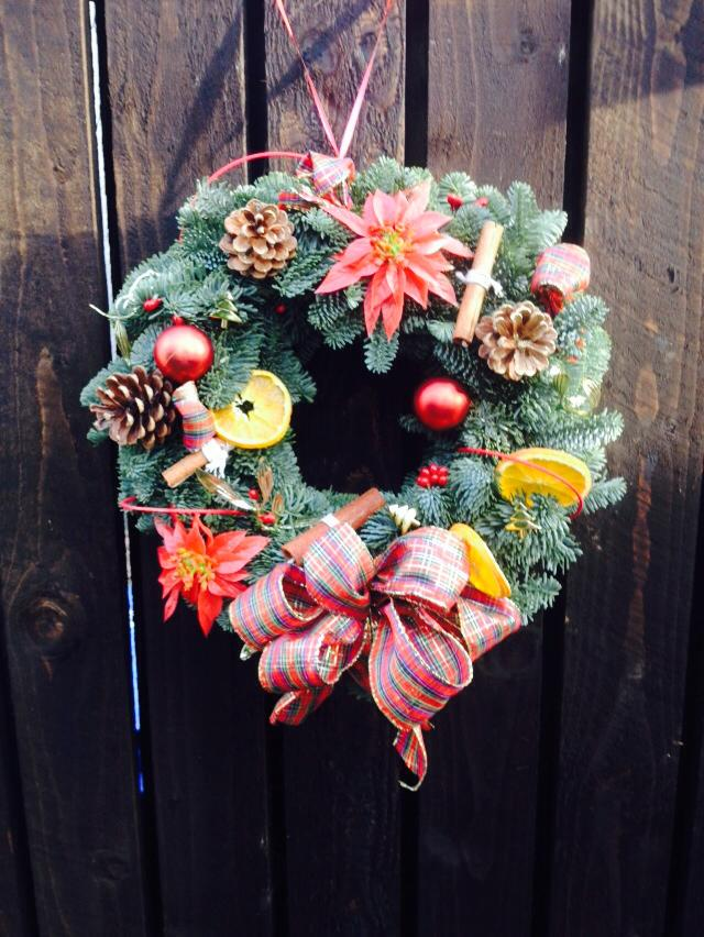 spruce wreath with tartan and oranges