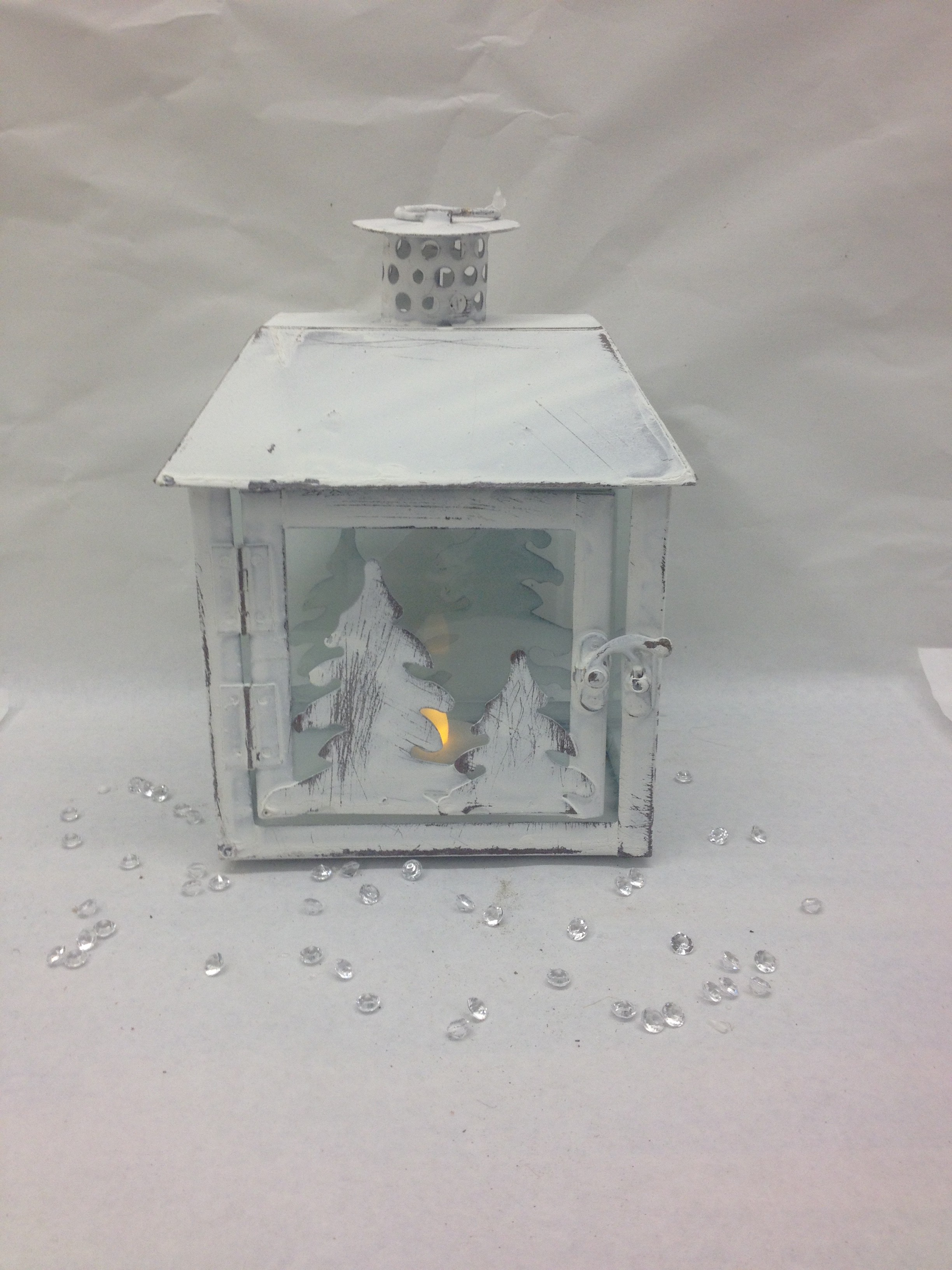 Metal lantern with with trees