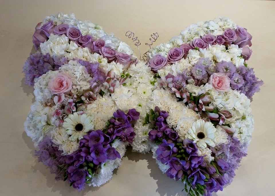 white and purple butterfly funeral tribute